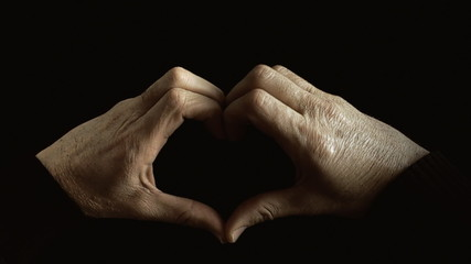Hands heart shape raising black