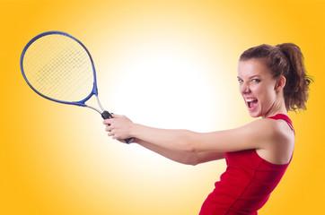 Woman playing tennis on white