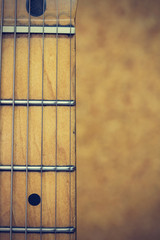 Close up macro of guitar strings vintage style
