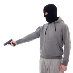 profile view of man in black mask aiming with gun isolated on wh
