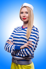 Woman in sailor costume isolated on white