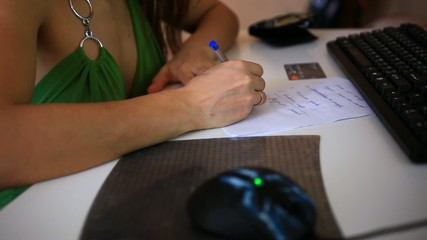 Woman's hand writes plan purchases and is a work plan. Entering