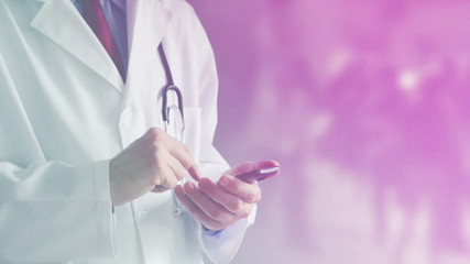 Male Doctor with Smart Phone scheduling Medical Exam