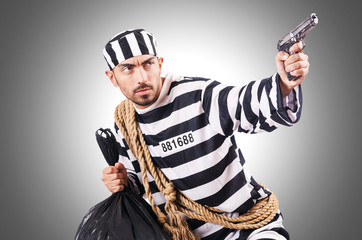 Convict criminal in striped uniform