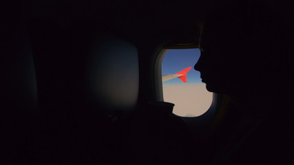 the girl on the plane, drinking water