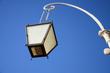 A street light against the blue sky