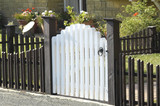 white garden gate and low fence