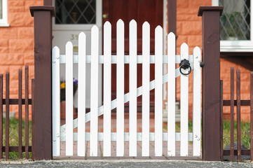 picket fence gate at the front of a home