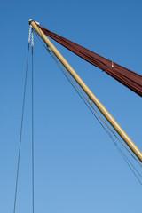 vintage sailboat rigging against blue sky