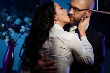 Kissing couple. Office romance concept