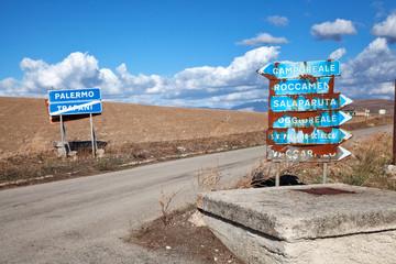 Rusty road signs along a sicilian road