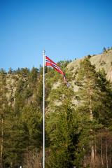 Norwegian pennant on a pole with mountains