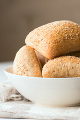 Oven baked bread in bowl vertical close up