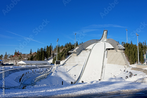 Holmenkollen ski jump in Oslo Norway at sunny winter day - 80005374