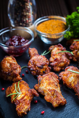 BBQ chicken wings with spices and dip
