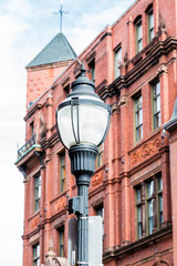 Classic Old Lamp Post by Brick Building