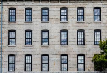 Eighteen Windows in Granite Block Wall