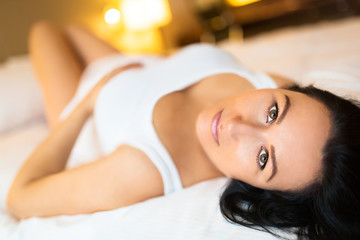 Beautiful pregnant woman lying in bed