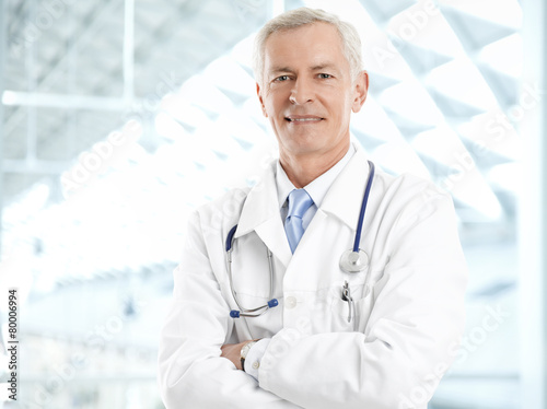 Portrait of a male doctor with digital tablet - 80006994