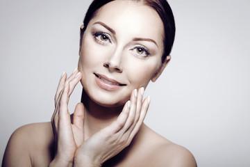 Beautiful Spa Woman Touching her Face. Perfect Fresh Skin.