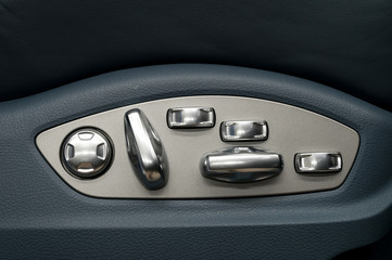 Buttons for adjusting seat position. Car interior detail.