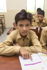 Indian boy in class room