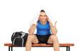 Worried male sportsman sitting on a bench