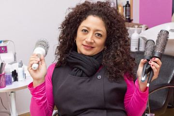 woman with brushes and combs in hairdressing