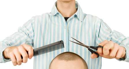 hairdresser holding scissors and comb on a white