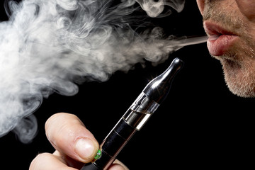 close up portrait of a man smoking an e-cigarette