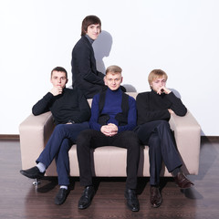Young men sitting on a sofa