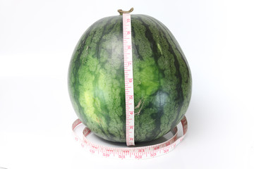 Watermelon with measuring the length around.