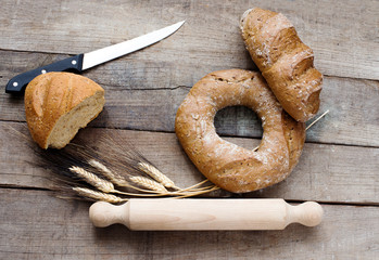 cereal bread with bread knife over wood