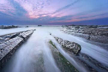 rocks in Barrika beach at sunset