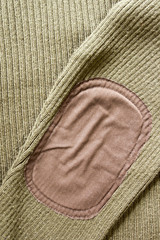 Patch on the sleeve sweater