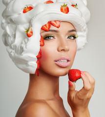 beautiful girl, eat dessert. Strawberries and cream