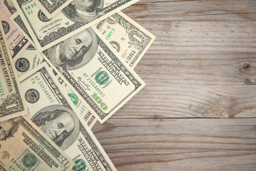 Bank notes on wooden background, vintage tone.