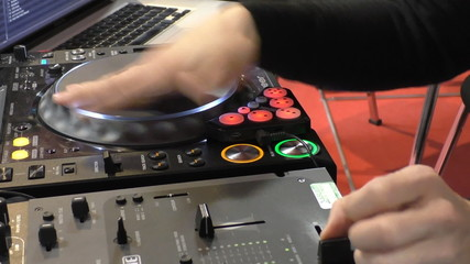 Dj mixing and scratching turntable