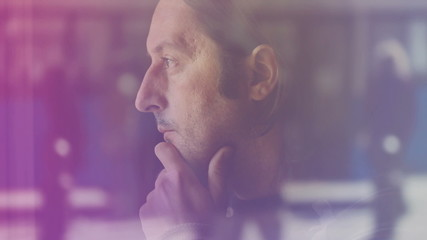 Lonely Adult Caucasian Man Thinking and Looking through Window