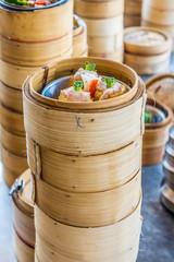 Small steamer baskets of Dim Sum in restaurant