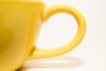 Franment yellow cup of tea on a white background