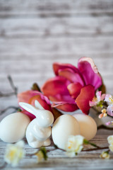 Rabbit Figurine with White Eggs and Flowers