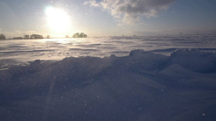 Snowstorm in the arctic. Frozen snow drifts.