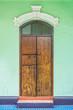 The old wooden door of vintage building