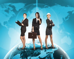 Business womens in suits, blouses, skirts, smiling and looking