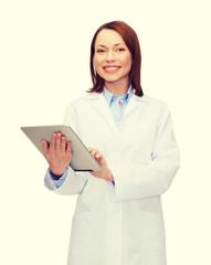 smiling female doctor and tablet pc computer