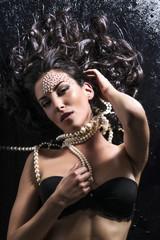 beautiful woman with jewelry posing elegantly