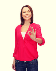 woman in casual clothes showing ok gesture