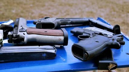 Guns on the blue table, shooting range