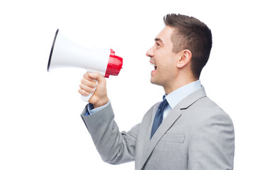 happy businessman in suit speaking to megaphone